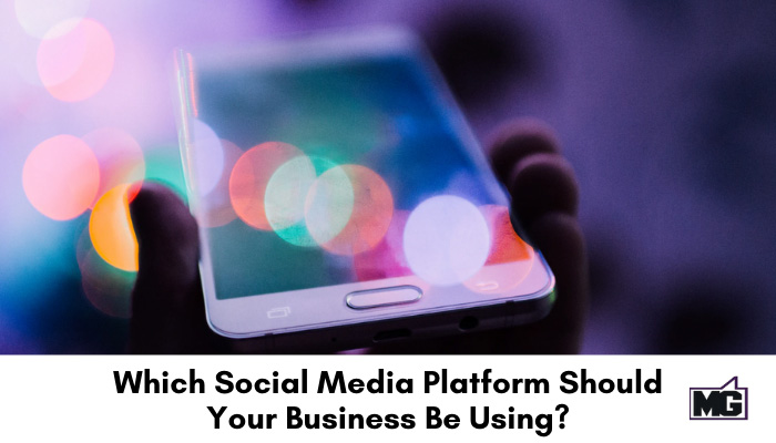 Hand holding a mobile phone symbolizing where you find your social media platforms.