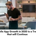 Hip guy using a mobile app for business.